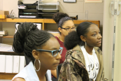 Seniors Veronica Gunn, Emari Green and Toyie Bullock are maintaining focus during the meeting and really considering some of the ideas their fellow peering were discussing.
