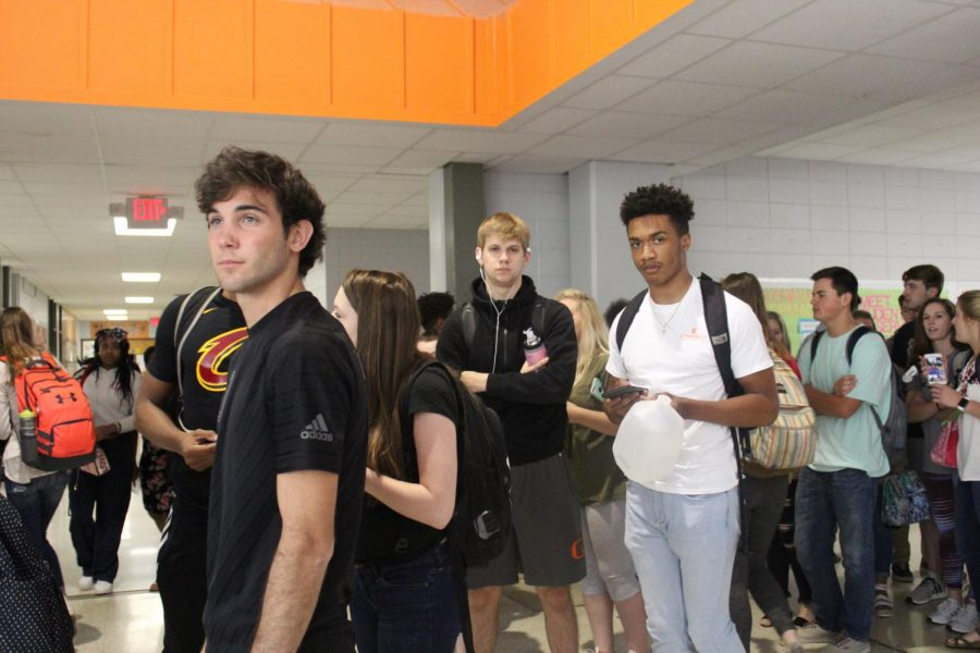 Seniors gather in line to receive their cap and gowns for graduation, expected June 8.