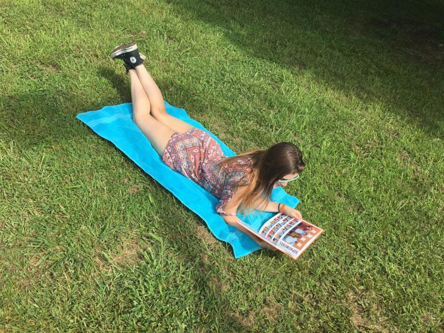 Yearbook+editor+Katie+Long+relaxes+on+the+OHS+campus+after+a+long+junior+year.+