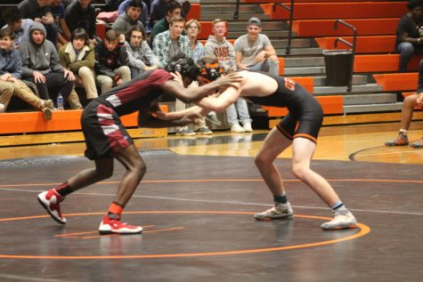 Here is a student from the wrestling team going head to head with a competitor.